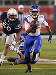 San Jose State's Thomas Tucker (3) runs past Nevada defenders during the first half of an NCAA college football game in Reno, Nev., on Saturday, Nov. 16, 2013.<br /> (AP Photo/ Cathleen Allison).