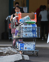 PARKLAND, FL - JULY 31: People are seen stocking up on supplies as Hurricane Isaias tracks towards Florida in addition to Florida reporting more than 9,007 new COVID-19 cases Friday and 257 deaths on July 31, 2020 in Parkland, Florida. Credit: mpi04/MediaPunch