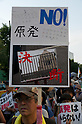 September 19, 2011, Harajuku, Tokyo, Japan - An Anti-Nuclear protester display a placard at the 'Sayonara-Nukes' rally as he marches through the streets of Harajuku. Police and local media estimates put numbers attending at between 20-50,000. (Photo by Bruce Meyer-Kenny/AFLO) [3692]