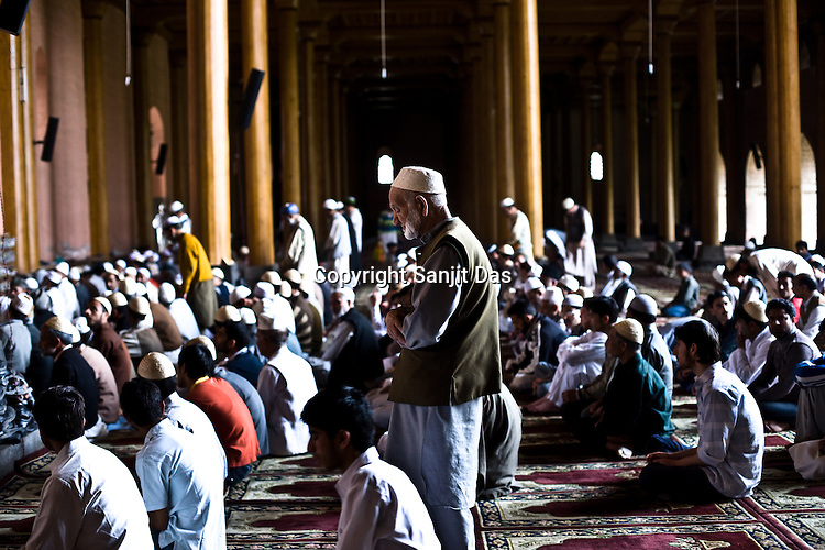 Pious muslims are seen offering friday prayers in the Jamia Masjid in downtown Srinagar, summer capital of Jammu and Kashmir, India. ..Kashmir went into polls on the 4th round of Indian general elections. About 26 percent polling was recorded in the Indian parliamentary elections held in Kashmir on Thursday, May 7th 2009. The poll percentage was on the higher side this year as compared to 2004 polls when 15.04 percent polling was recorded.