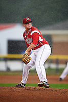 Batavia Muckdogs pitcher Nick White (16) delivers a pitch in the rain during a game against the Mahoning Valley Scrappers on July 1, 2015 at Dwyer Stadium in Batavia, New York.  The game was called after four pitches because of rain.  (Mike Janes/Four Seam Images)