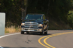 2014 Ram 1500 EcoDiesel Crew Cab 4×4 SLT on a country road.