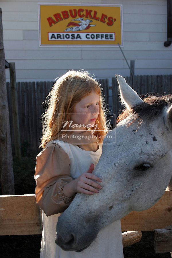 A young girl with a white horse