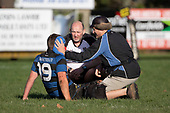 Referee Bill Howie checks on the wellbeing of Ryan Spicer after he took a knock to the head. Counties Manukau Premier Club Rugby game between Onewhero and Waiuku, played at Onewhero on Saturday May 26th 2018. Onewhero won the game 24 - 20 after leading 17 - 12 at halftime. <br /> Onewhero Silver Fern Marquees 24 -Vaughan Holdt, Filipe Pau, Sean Bagshaw tries, Rhain Strang 3 conversions, Rhain Strang penalty.<br /> Waiuku Brian James Contracting 20 - Christian Walker, Fuifatu Asomua, Aaron Yuill tries, Christian Walker conversion, Christian Walker penalty .<br /> Photo by Richard Spranger.