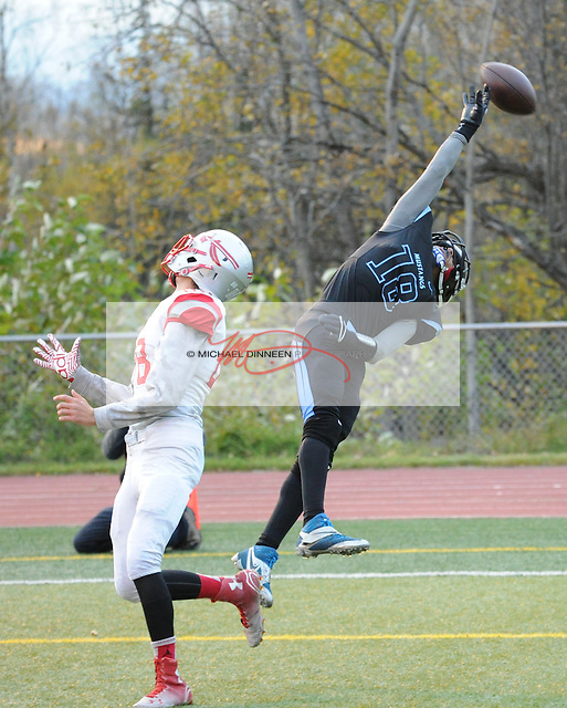 Ramall Maad reaches for a pass as Wasilla defender Ethan Patnode reacts at Chugiak High School Friday, Sept. 23, 2016.  Photo for the Star by Michael Dinneen