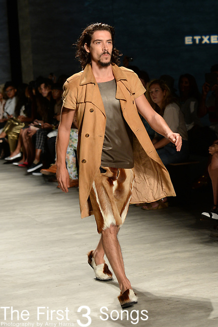 A model walks the runway at the ETXEBERRÍA fashion show during Mercedes-Benz Fashion Week Spring 2015 at The Pavilion at Lincoln Center in New York City.