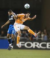 Brian Ching, right, and Jason Hernandez, left, battle for a head ball, .San Jose Earthquakes over the Houston Dynamo 2-1, at Buck Shaw Stadium in Santa Clara, Calif., Thursday, May 22, 2008. .