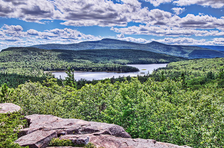 The view from Sunset Rock, looking west at North Lake, South Lake and mountains including Hunter Mountain, in the Catskill State Park, near Haines Falls, New York. This was a favorite location of Thomas Cole and other painters of the Hudson River School of Painting.