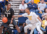 California's Richard Solomon defending Colorado's Wesley Gordon during a game at Haas Pavilion in Berkeley, California on March 8th, 2014. California defeated Colorado 66 - 65