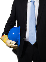 The white collar engineer with a blue helmet under his arms ready to do the job