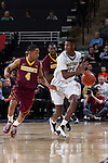 Cornelius Hudson (25) of the Wake Forest Demon Deacons is guarded by Deandre Mathieu (4) of the Minnesota Golden Gophers during first half action at the LJVM Coliseum on December 2, 2014 in Winston-Salem, North Carolina.  The Golden Gophers defeated the Demon Deacons 84-69. (Brian Westerholt/Sports On Film)