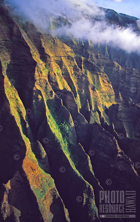 Steep cliffs of Honopu Valley, Na Pali Coast State Park, late afternoon light, aerial photo
