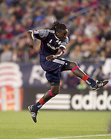 New England Revolution midfielder Shalrie Joseph (21) follows through on a shot. Real Salt Lake defeated the New England Revolution, 2-1, at Gillette Stadium on October 2, 2010.