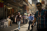 June 12, 2014 - Tehran, Iran. Customers walk through the Grand Bazaar of Tehran. Despite the increasing number of malls opened around the country, many Iranians still prefer to shop in traditional bazaars. © Thomas Cristofoletti / Ruom