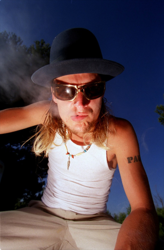 Kid Rock blows smoke as he prepares to go on stage during the KROQ summer concert.