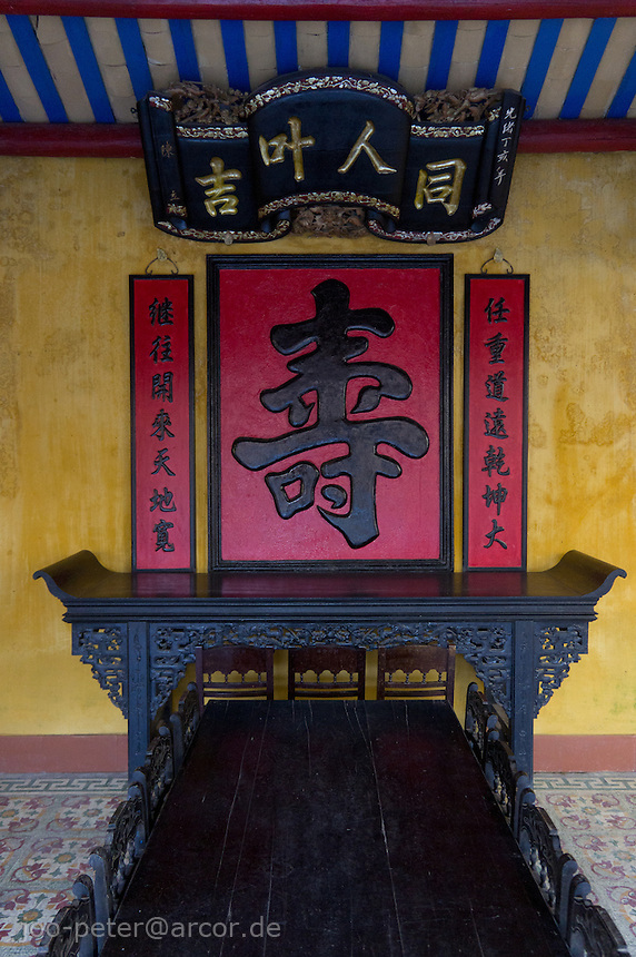shrine with chinese calligraphy relief  in temple in  the city Hoi An, Vietnam