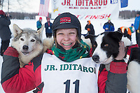 Joan Klejka poses with lead dogs the finish line of the 2016 Junior Iditarod in Willow, Alaska, AK  February 28, 2016