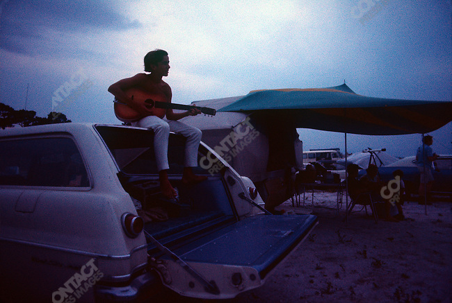 Launch of Apollo 11, first manned exploration of the moon. Spectators camp on the beach across from the launch site the night before the launch. Titusvill, Florida, USA, July 15, 1969