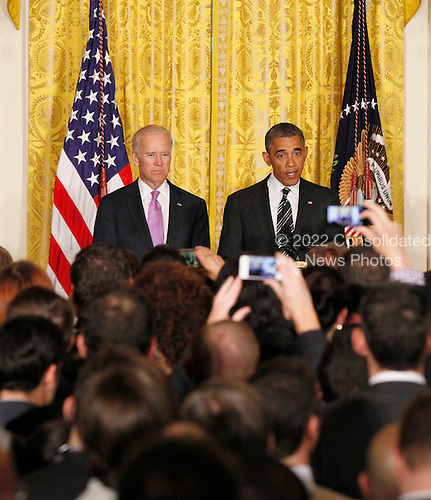 United States President Barack Obama makes remarks next to Vice President Joe Biden at the LGBT Pride Month celebration in the East Room at the White House on June 13, 2013.  <br /> Credit: Molly Riley / Pool via CNP