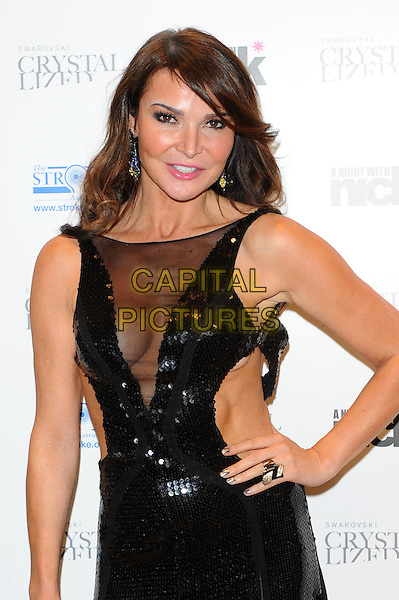 "Lizzie Cundy.The ""A Night With Nick"" charity event in aid of The Stroke Association, Swarovski CRYSTALLIZED, Gt. Marlborough St., London, England..December 6th, 2011.half length black dress sleeveless sheer mesh plunging neckline cleavage ring sequins sequined hand on hip .CAP/CJ.©Chris Joseph/Capital Pictures."