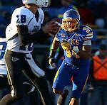 BROOKINGS, SD - NOVEMBER 9:  Doug Peete #34 from South Dakota State University eyes quarterback Robert Tonyan #18 from Indiana State University Saturday at Coughlin Alumni Stadium. (Photo by Dave Eggen/Inertia)