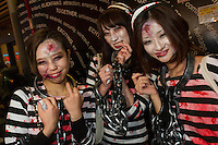 Three Japanese women, dressed as prisoners during the Halloween celebrations in Shibuya, Tokyo, Japan. Saturday October 29th 2016 Halloween celebration in Japan have grown massively in the last few years. To ensure the safety of the crowds in Shibuya this year, the police closed several roads leading to the famous Hachiko Square, allowing costumed revellers to spread over a larger area.