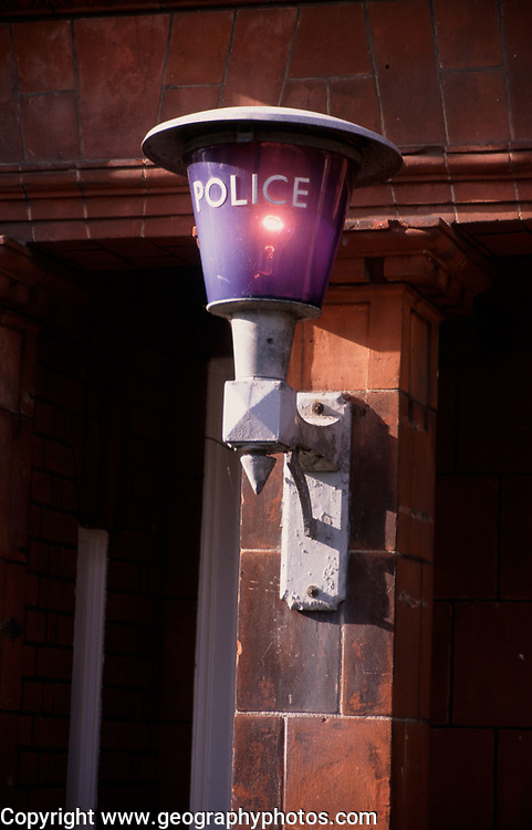 A728G7 Traditional British blue police lamp outside a police station