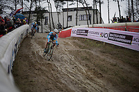 In lap 1 Daan Hoeyberghs (BEL) is the first rider to descend this tricky, muddy slope <br /> <br /> U23 men's race<br /> <br /> UCI 2016 cyclocross World Championships / Zolder, Belgium