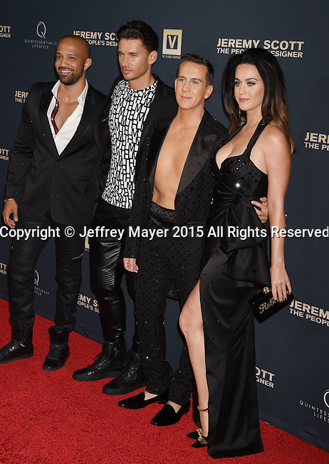 HOLLYWOOD, CA - SEPTEMBER 08: (L-R) Producer Edwin Mejia, director/producer Vlad Yudin, designer Jeremy Scott and singer Katy Perry arrive at the Premiere Of The Vladar Company's 'Jeremy Scott: The People's Designer' at TCL Chinese 6 Theatres on September 8, 2015 in Hollywood, California.