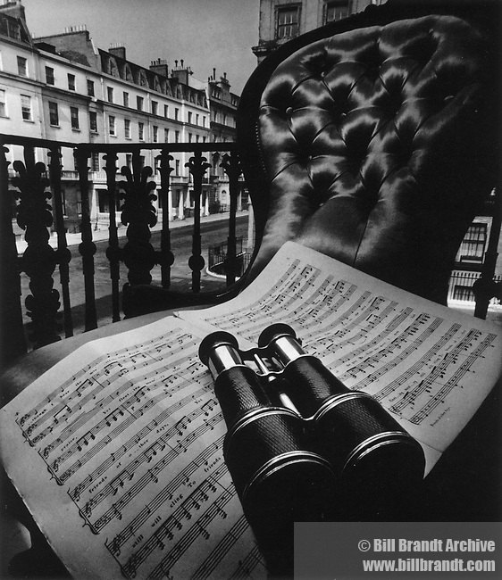 Binoculars and music on chair
