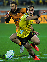 Jaguares' Ramiro Moyano grubbers past Hurricanes' Wes Goosen during the Super Rugby match between the Hurricanes and Jaguares at Westpac Stadium in Wellington, New Zealand on Friday, 17 May 2019. Photo: Dave Lintott / lintottphoto.co.nz