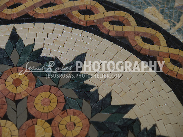 Detail of a handmade table with mosaics in Nebo, Jordan
