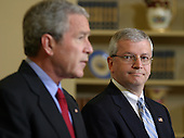 Washington, D.C. - March 28, 2006 -- United States President George W. Bush, left, introduces Office of Management and Budget (OMB) Director Joshua Bolten, right, as his choice to replace Andrew Card as White House Chief of Staff, in the Oval Office of the White House on March 28, 2006.<br /> Credit: Martin H. Simon - Pool via CNP