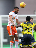Blackpool's Kelvin Mellor jumps with  Oxford United's Jonathan Obika<br /> <br /> Photographer Mick Walker/CameraSport<br /> <br /> The EFL Sky Bet League One - Oxford United v Blackpool - Saturday 6th January 2018 - Kassam Stadium - Oxford<br /> <br /> World Copyright &copy; 2018 CameraSport. All rights reserved. 43 Linden Ave. Countesthorpe. Leicester. England. LE8 5PG - Tel: +44 (0) 116 277 4147 - admin@camerasport.com - www.camerasport.com