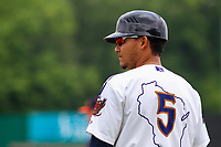 Wisconsin Timber Rattlers coach Fidel Pena (5) looks on during a Midwest League game against the Bowling Green Hot Rods on July 22, 2018 at Fox Cities Stadium in Appleton, Wisconsin. Bowling Green defeated Wisconsin 10-5. (Brad Krause/Four Seam Images)