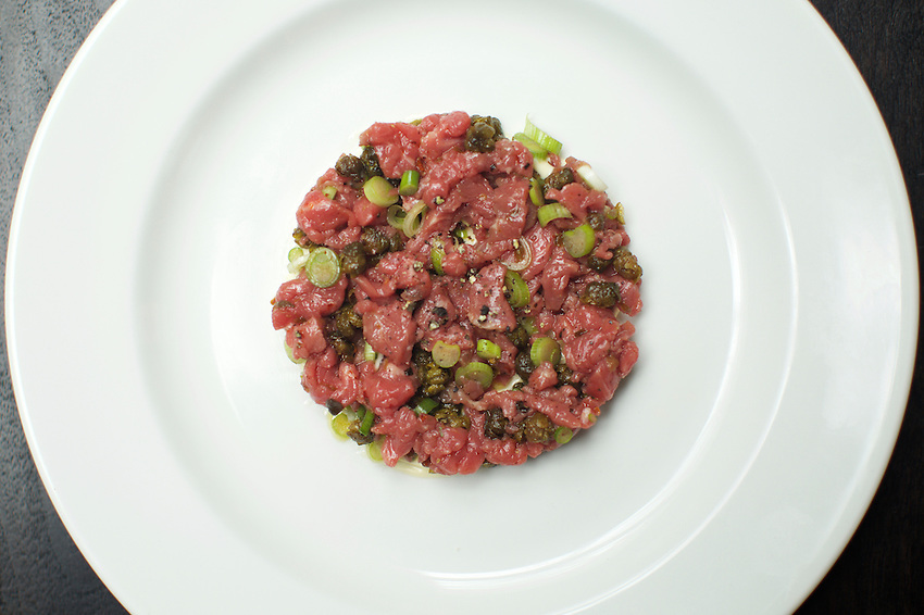 NEW YORK, NY - May 3, 2016: Steak Tartare with fried capers, spring onions &amp; spiced mayonnaise at Metrograph Commissary. The new restaurant at Lower East Side movie theater, Metrograph opens on Thursday, May 5th.<br /> <br /> CREDIT: Clay Williams for New York Magazine.<br /> <br /> &copy; Clay Williams / claywilliamsphoto.com