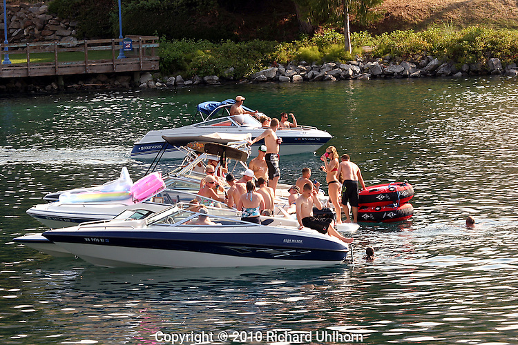 In tough economic times, boat owners often raft their boats together and party on the water without having to use fuel. They will commonly raft together for an entire day.