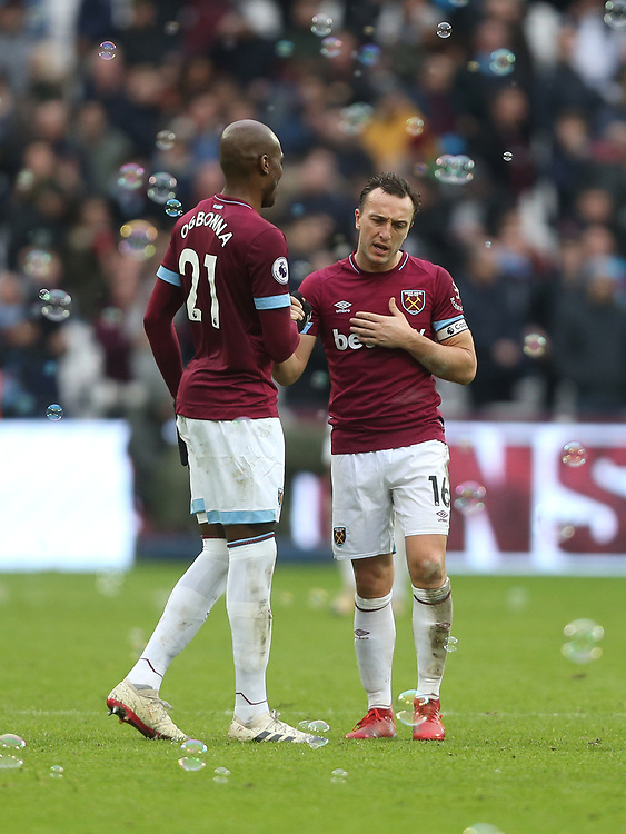 West Ham United's Angelo Ogbonna and Mark Noble at the end of the game<br /> <br /> Photographer Rob Newell/CameraSport<br /> <br /> The Premier League - West Ham United v Arsenal - Saturday 12th January 2019 - London Stadium - London<br /> <br /> World Copyright © 2019 CameraSport. All rights reserved. 43 Linden Ave. Countesthorpe. Leicester. England. LE8 5PG - Tel: +44 (0) 116 277 4147 - admin@camerasport.com - www.camerasport.com