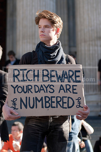 15/10/2011. LONDON, UK. Protesters stand outside St Pauls Cathedral at the beginning of Occupy The London Stock Exchange. As part of an anti-capitalist protest taking place in cities across the globe, demonstrators attempt to occupy Paternoster Square in London under the name Occupy London Stock Exchange.  After being refused entry to the square itself thousands of protesters occupied the area outside St Paul's Cathedral with some erecting tents. Credit should read: Matt Cetti-Roberts