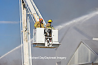 63818-022.13 Firefighters extinguishing warehouse fire using aerial ladder truck, Salem, IL