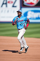 Spokane Indians center fielder Julio Pablo Martinez (27) jogs off the field between innings of a Northwest League game against the Vancouver Canadians at Avista Stadium on September 2, 2018 in Spokane, Washington. The Spokane Indians defeated the Vancouver Canadians by a score of 3-1. (Zachary Lucy/Four Seam Images)