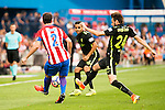 Atletico de Madrid's player Diego Godín and Sporting de Gijon's player Douglas and Duje Cop during a match of La Liga Santander at Vicente Calderon Stadium in Madrid. September 17, Spain. 2016. (ALTERPHOTOS/BorjaB.Hojas)