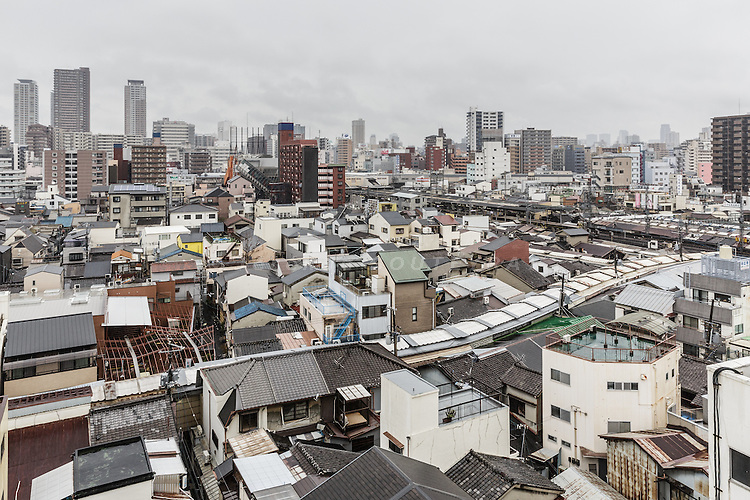 Osaka, Japan, November 25 2016 - Overview of Tsuruhashi, the home of the largest Korean community (Zainichi) in Japan.<br /> Osaka&rsquo;s Korea town in Tsuruhashi is the home of the largest Korean community (Zainichi) in Japan.<br /> The majority of Koreans in Japan are Zainichi Koreans, often known simply as Zainichi , who are the permanent ethnic Korean residents of Japan. The term &quot;Zainichi Korean&quot; refers only to long-term Korean residents of Japan who trace their roots to Korea under Japanese rule, distinguishing them from the later wave of Korean migrants who came mostly in the 1980s. The estimated population is about 500,000 people. As of 2016, about 90% of them have South Korean nationality and 10% of them are considered by Japanese administration as &laquo;&nbsp;Korean&nbsp;&raquo; (chosenjin), the word used for korean people before the division between North and South Korea in 1948. The ratio used to be the opposite in the 1950ies.