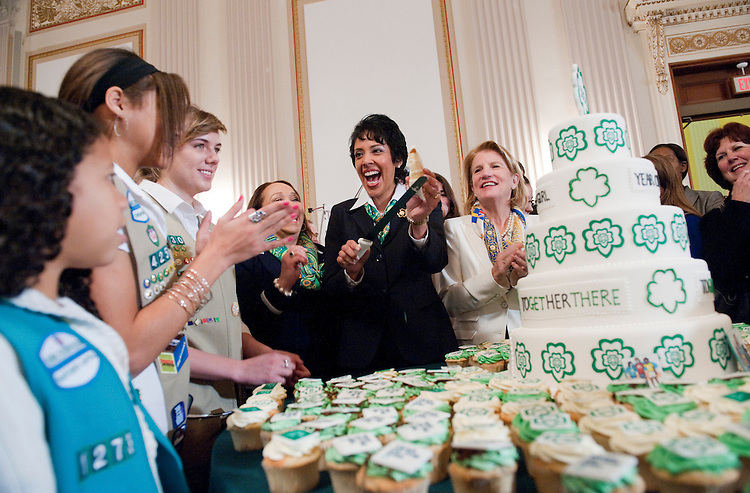 UNITED STATES - FEBRUARY 01:  Anna Marie Chavez, center, CEO Girl Scouts, and Rep. Shelley Moore Capito, W.Va., to her right, cut cake during a celebration of the Girl Scouts' 100th birthday in Cannon Caucus Room.  The event featured addresses by House Minority Leader Nancy Pelosi, D-Calif., HHS Secretary Kathleen Sebelius and other Congressional leaders.  (Photo By Tom Williams/CQ Roll Call)