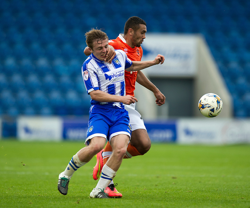 Blackpool's Colin Daniel holds off the challenge from Colchester United's Tom Lapslie<br /> <br /> Photographer Ashley Western/CameraSport<br /> <br /> The EFL Sky Bet League Two - Colchester United v Blackpool - Saturday 10th September 2016 - Colchester Community Stadium - Colchester<br /> <br /> World Copyright &copy; 2016 CameraSport. All rights reserved. 43 Linden Ave. Countesthorpe. Leicester. England. LE8 5PG - Tel: +44 (0) 116 277 4147 - admin@camerasport.com - www.camerasport.com