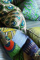 Colourful patterned cushions on a striped sofa in Singita Pamushana Lodge, Malilongwe Trust, Zimbabwe