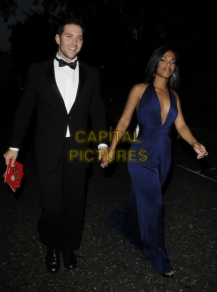 guest & FREEMA AGYEMAN .TV Choice Awards 2011 departures held at the Savoy Hotel, London, England..September 13th, 2011.full length blue dress plunging neckline holding hands black tuxedo.CAP/CAN.©Can Nguyen/Capital Pictures.
