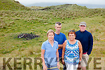 Holiday maker Paula Cantillon with locals Aidan O'Connor, Eileen Walsh and Martin Lynch from the Maharees pictured near the remains of one of the campfires on the dunes which they say is leading to the ecological destruction the area.