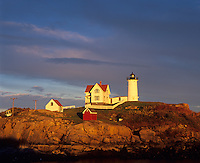 York County,ME: Cape Neddick (Nubble) Light Station (1879) in evening light under clearing storm clouds
