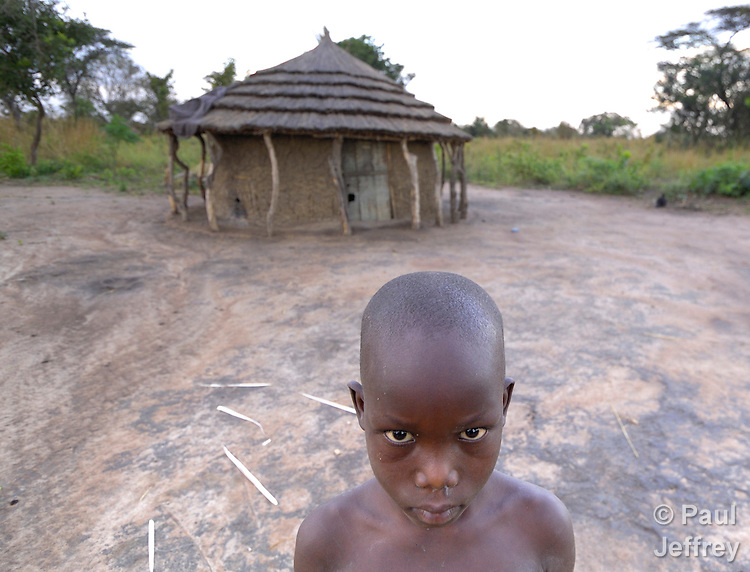 A once displaced boy is now back home in northern Uganda. Families who've been displaced by internal conflict for years have returned to Omeon, their village of origin, and are rebuilding their huts, cultivating their fields, and renewing their bond with the land. These families began returning home in April 2007.